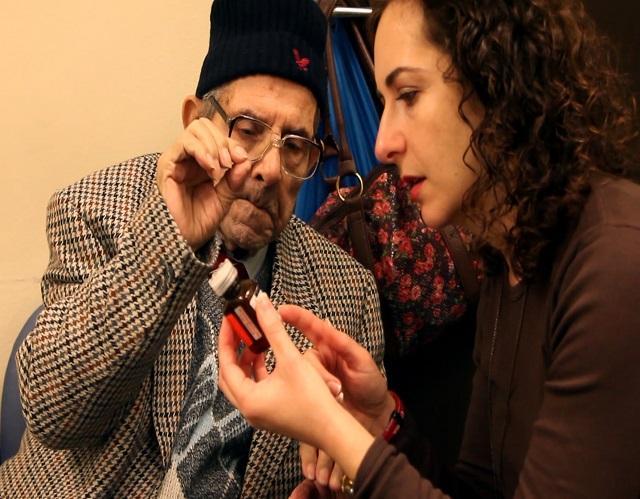 Support Worker explaining dosage of pills to deaf man