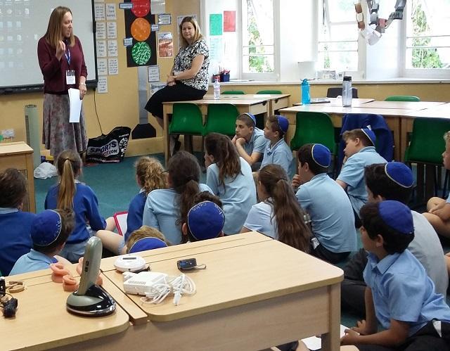 School children being taught deaf awareness training in schools