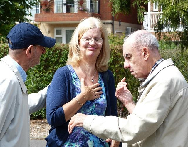 Deafblind man in park with volunteer